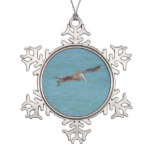 Gliding Pelican Snowflake Pewter Christmas Ornament